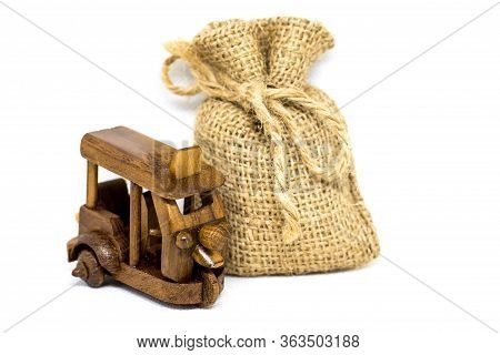Retro Old Toy Tricycle Obsolete Wooden And Small Linen Bag In Thailand