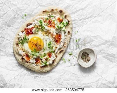 Delicious Breakfast - Flatbread With Fried Egg, Greek Yogurt, Chili Sauce And Cheese On Light Backgr