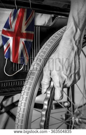 Senior In Wheelchair At Nursing Home In Black And White With Hanging British Flag Face Mask In Color