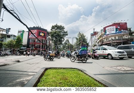 Saigon Vietnam - October 12 2013; Typically Asian Street Busy With Motor Cycles And Cars Heading In