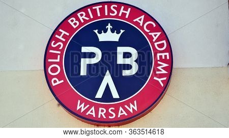 Warsaw, Poland. 27 April 2020. Sign Polish British Academy. Company Signboard Polish British Academy