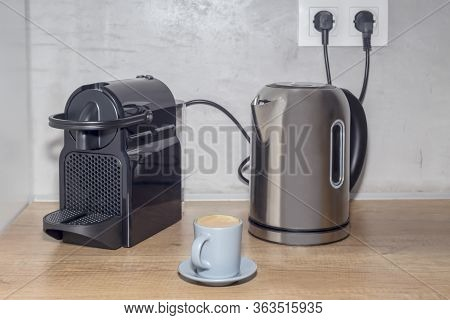 The Machine For Preparation Espresso Coffee, Electric Kettle And Blue Cup With Delicious, Hot Espres