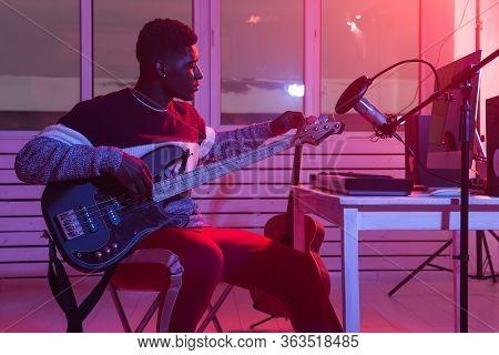 Create Music And A Recording Studio Concept - Black Man Guitarist Recording Electric Bass Guitar Tra