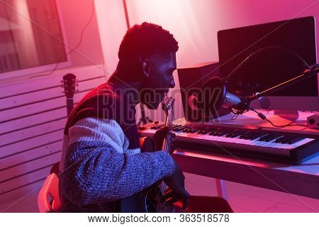 Create Music And A Recording Studio Concept - African American Man Guitarist Recording Electric Guit