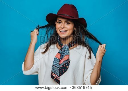Beautiful Young Brunette Holds Her Hair, Looking Happy, Dressed In White Sweater, Burgundy Hat With