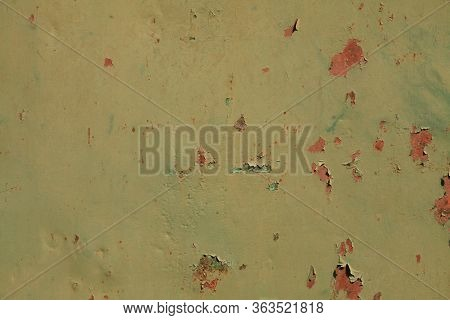 Metallic Wall Background, Texture, Colored In Green Color With Pieces Of Peeling Paint And Rusty Cra