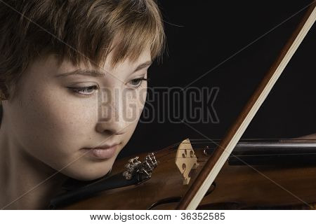 Slight Smile On Teenage Girl Violinist