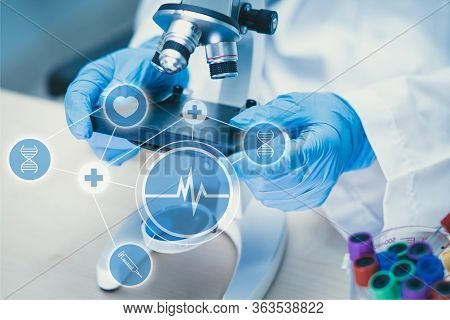 Scientist Biochemist Or Microbiologist Working Research With A Microscope In Laboratory. For Protect