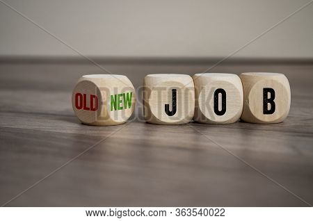 Cubes And Dice On Wooden Background With Word New Job Versus Old Job