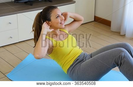 Slim Sporty Girl Doing Abs Workout. Fitness Woman Doing Strength Training Abs Situps Bodyweight Floo