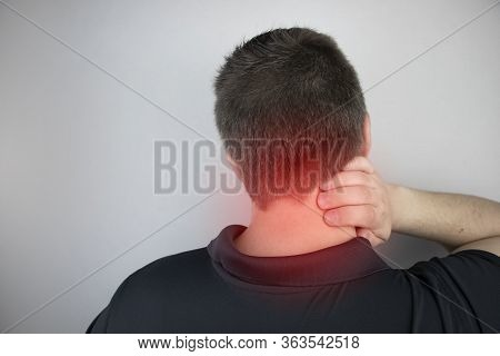 A Man Suffers From Pain In The Neck, Massages The Cervical Spine With His Hand. Osteochondrosis, Her