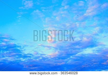 Sunset sky background. Picturesque colorful clouds lit by evening soft sunlight. Vast sky landscape panoramic scene - colorful sky view
