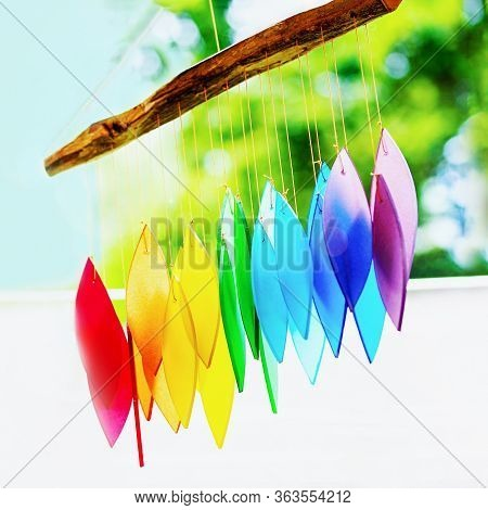 Rainbow Glass Wind Chimes Or Windchime On Nature Background. Feng Shui Symbol. Copy Space