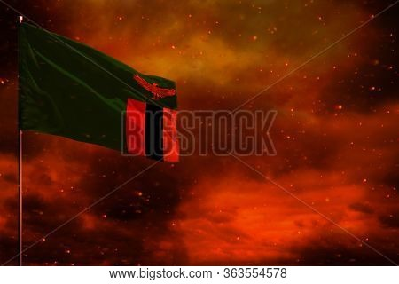 Fluttering Zambia Flag Mockup With Blank Space For Your Data On Crimson Red Sky With Smoke Pillars B
