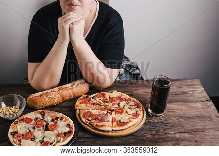 Nerve Food, Addiction, Eating Disorders, Bulimia. Overweight Woman Sit At The Table With Big Amount