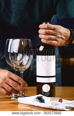 The Culture Of Winemaking. Samelie Offers Wine, The Hands Of A Winemaker With A Glass Of Wine And An