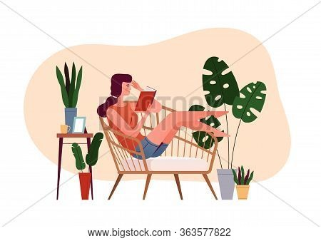 Young Girl Sits In An Armchair And Reads A Book. The Concept Of A Cozy Reading At Home. Home Daily A