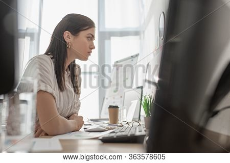 Selective Focus Of Information Security Analyst Working With Computers In Office