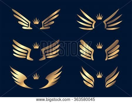 Set Of Six Pairs Of Gold Wings With Crowns. Vector Illustration.