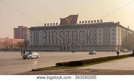 Pyongyang / Dpr Korea - November 12, 2015: Kim Il-sung Square And Government Buildings Decorated Wit