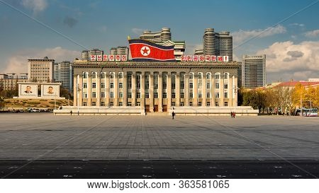 Pyongyang / Dpr Korea - November 12, 2015: Kim Il-sung Square And Government Building Decorated With