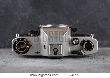 The Old Soviet 35 Mm Film Camera Kiev 19 Without Lens With Nikon Mount, Released 1989 On Gray Cement