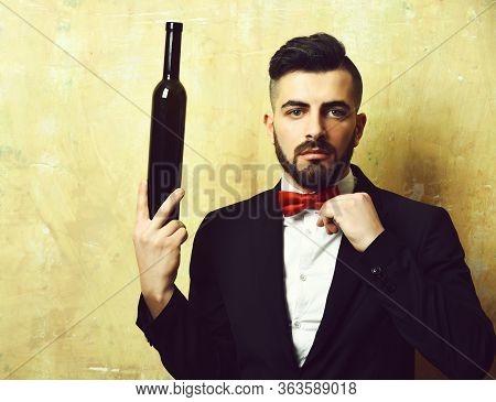 Bearded White Collar Worker Holds Bottle Of Alcoholic Drink