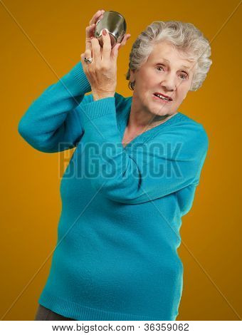 Portrait Of A Angry Mature Woman On Brown Background poster