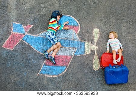 Two Little Children, Kid Boy And Toddler Girl Having Fun With With Airplane Picture Drawing With Col