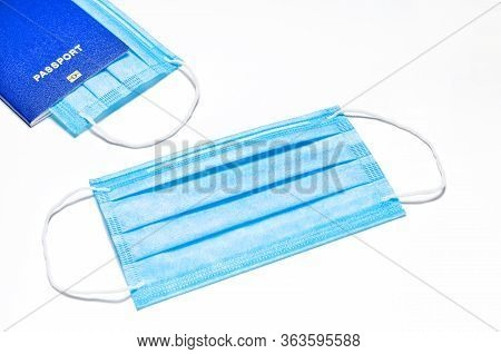 The Medical Facial Mask Lies On A White Background, In The Upper Left Corner There Is A Blue Foreign