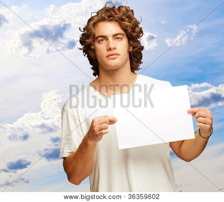 Young Casual Man Holding A Blank Message, Outdoor poster