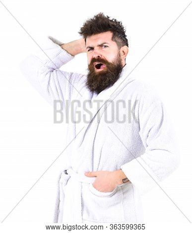 Man With Beard And Mustache Yawning While Scratching, Itching Head, Isolated On White Background. Ma