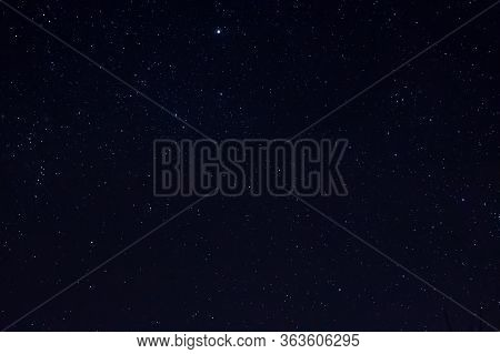 Long Exposure Night Photo Of A Bright Stars. A Lot Of Stars With Constellations. Far From The City.