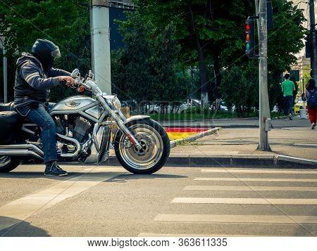 Bucharest/romania - 04.27.2020: Biker On A Harley-davidson Motocycle Waitting At The Traffic Light..