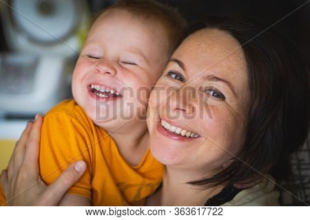 Happy Family Laughing Faces, Mother Holding Adorable Child Baby Boy, Smiling And Hugging, Close Up B