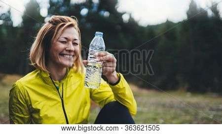 Happy Sport Girl Laughing Quenches Thirst After Fitness. Smile Person Drinking Water From Plastic Bo