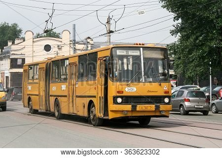 Chelyabinsk, Russia - July 2, 2008: Yellow Articulated Bus Ikarus 280 In The City Street.