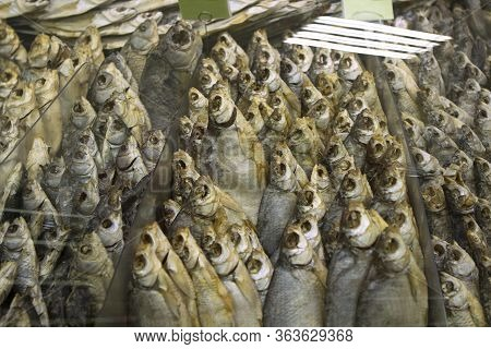 A Lot Of Dry Dried Stockfish River Fish Bream On The Counter In A Supermarket