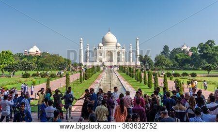 Agra, Uttar Pradesh / India - October 6, 2019: Tourists Visiting Taj Mahal Mausoleum, Unesco World H