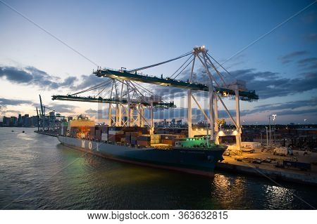 Miami, Usa - March 01, 2016: Freight Boat Mol Expeditor In Cargo Port. Container Ship And Cranes Ill