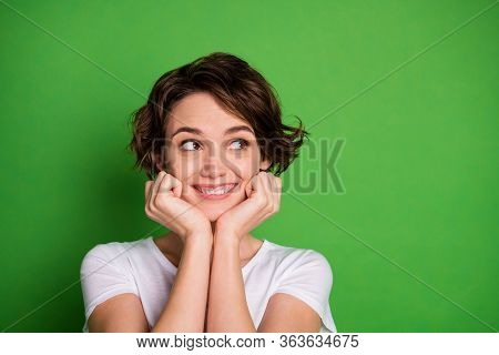 Closeup Photo Of Funny Attractive Cheerful Lady Wavy Bobbed Hairdo Look Side Empty Space Arms On Che