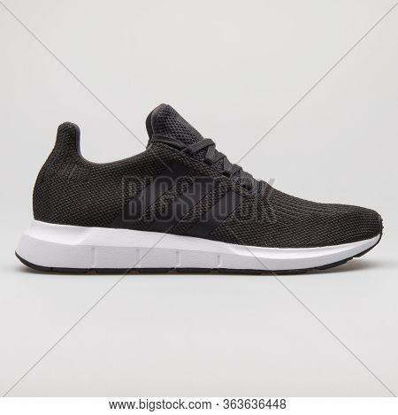 Vienna, Austria - February 19, 2018: Adidas Swift Run Black And White Sneaker On White Background.