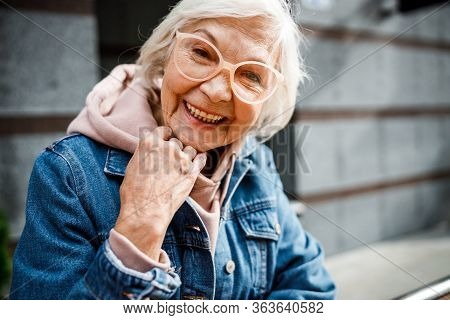 Smiling Aged Woman In Jeans Jacket Stock Photo