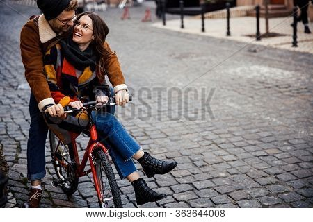 Lovely Couple On One Bike In The Street Stock Photo
