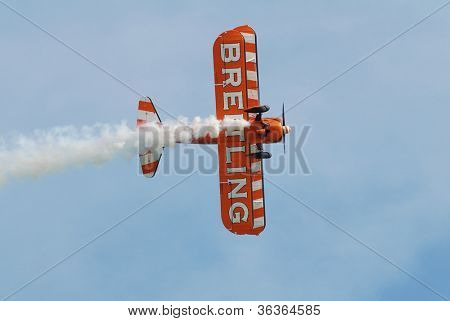EASTBOURNE, ENGLAND - AUGUST 11: The Breitling Wingwalkers display team perform at the Airbourne airshow on August 11, 2012 at Eastbourne, East Sussex. The team fly 1940s Boeing Stearman biplanes.