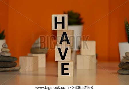 Words Have Written In Wooden Alphabet Letters Isolated On An Craft Paper - Carton Background With Em