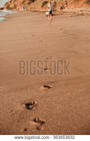 Footprints In The Sand Of A Fleeing Child