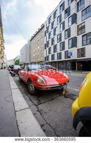 Vienna, Austrian - Jul 5, 2011: Beautiful Vintage Alfa Romeo Spider Red Vintage Convertible Parked O