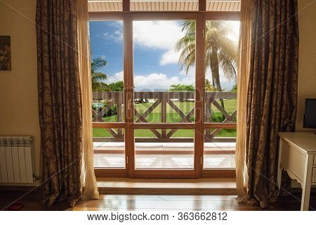 Closed Window And Beautiful Picture Outside, Nature View, Resort And Resting. Sunny Summers Or Sprin