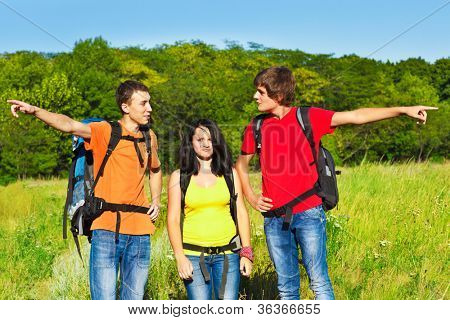 Male hikers showing opposite directions